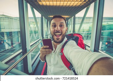 handsome man tourist taking a selfie in airport before journey taking flight