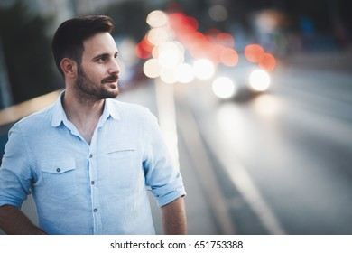 Handsome man walking at night