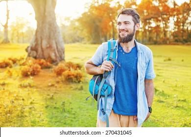 handsome man walking in a park