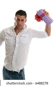 A handsome man waving a gift wrapped present