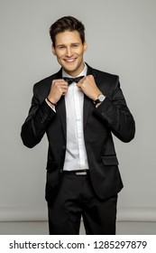Handsome man wear black suit and bow tie