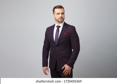 Handsome man wear blue suit in gray background.