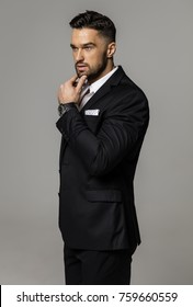 Handsome man wear classic black suit and thinking