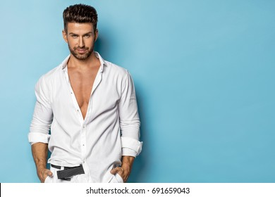 Handsome man wear white shirt and posing in studio