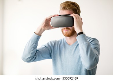 Handsome man wearing future technology VR glasses