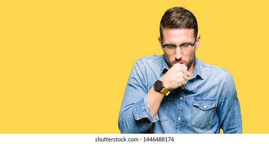 Handsome man wearing glasses feeling unwell and coughing as symptom for cold or bronchitis. Healthcare concept.