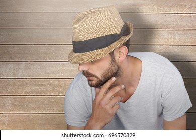 Handsome man wearing hat  against wooden surface with planks