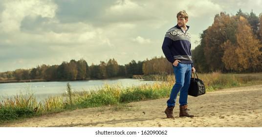 Handsome man wearing norwegian sweater