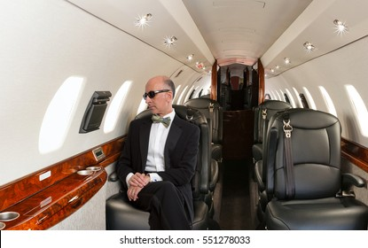 Handsome man wearing a tuxedo inside a private jet