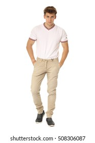 Handsome man in white shirt and beige pants