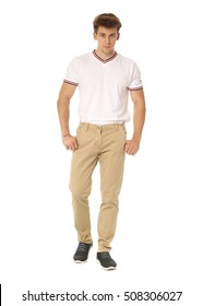 Handsome man in white shirt and brown pants