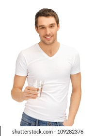 handsome man in white shirt with glass of water