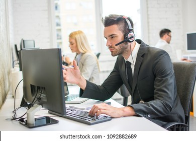 Handsome man working in call center.