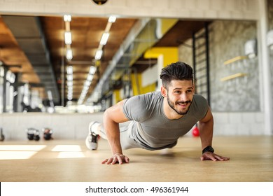 Handsome man working push ups at the gym.