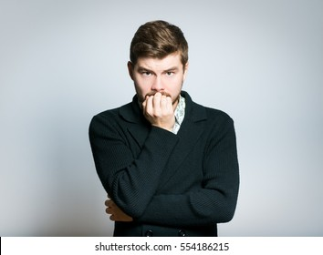 Handsome man worries about, isolated on background