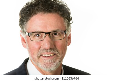 Handsome mature business man wearing glasses and smiling isolated on white.