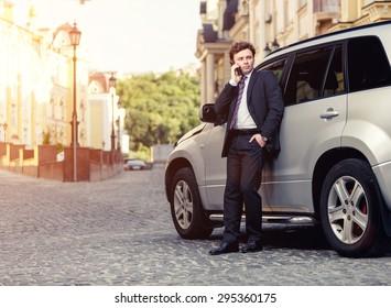 Handsome mature caucasian businessman outdoor wearing suit