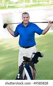 Handsome Mature Male smiling on the Golf Course
