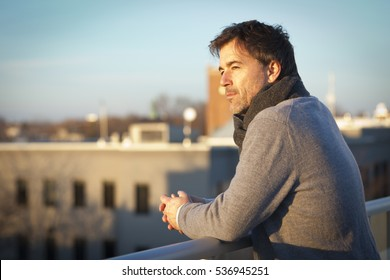 Handsome mature man dreaming on the roof