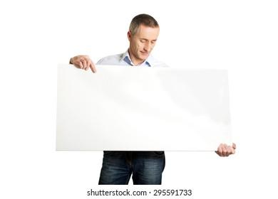 Handsome mature man holding an empty banner.