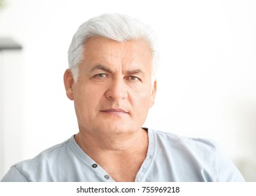 Handsome mature man at home