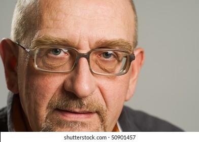 Handsome mature man posing on plain background