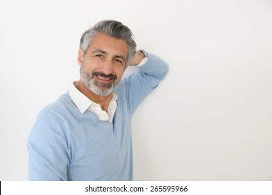 Handsome mature man standing on white background