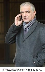 Handsome mature man talking at the phone