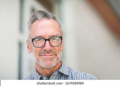 Handsome mature man wearing glasses