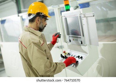 Handsome mature man working in the  modern furniture factory