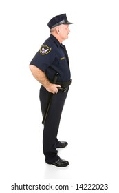 Handsome mature police officer in profile.  Full body isolated on white.