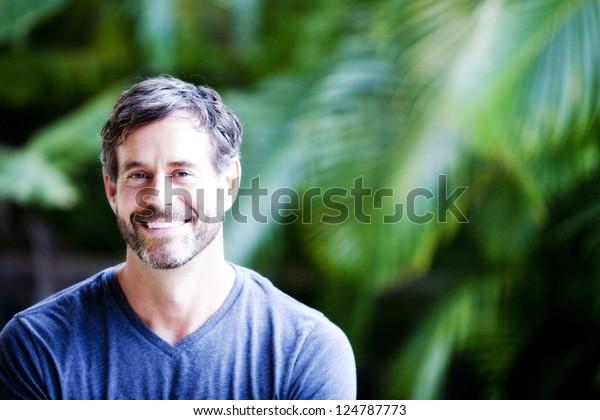 handsome maturing  man inviting smile