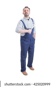 Handsome mechanic or repairman with spanner standing and posing confident as pride or winner concept isolated on white