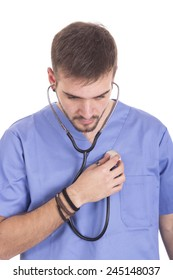 Handsome medical doctor using stethoscope on own heart