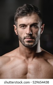Handsome men face close up portrait in the gym Fitness strength training workout bodybuilding concept background - portrait of muscular bodybuilder handsome man doing exercises in gym naked torso