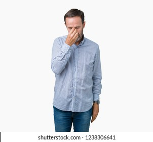 Handsome middle age elegant senior man over isolated background tired rubbing nose and eyes feeling fatigue and headache. Stress and frustration concept.