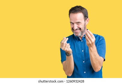 Handsome middle age elegant senior man over isolated background Doing money gesture with hand, asking for salary payment, millionaire business