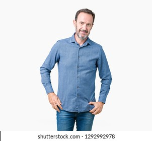 Handsome middle age elegant senior man over isolated background Relaxed with serious expression on face. Simple and natural looking at the camera.