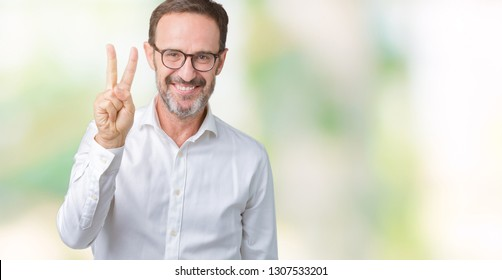 Handsome middle age elegant senior business man wearing glasses over isolated background showing and pointing up with fingers number two while smiling confident and happy.