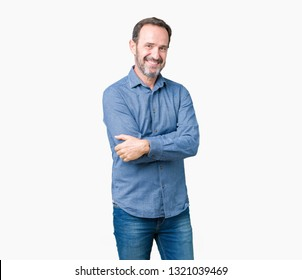 Handsome middle age elegant senior man over isolated background happy face smiling with crossed arms looking at the camera. Positive person.