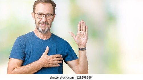 Handsome middle age hoary senior man wearin glasses over isolated background Swearing with hand on chest and open palm, making a loyalty promise oath