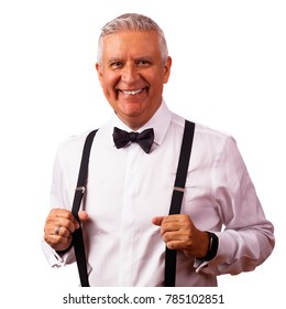 Handsome middle age man with bow tie and suspenders on a white background.