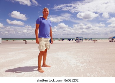 Handsome middle age man enjoying scenic South Beach in Miami.