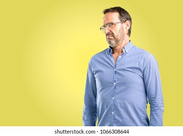 Handsome middle age man having skeptical and dissatisfied look expressing Distrust, skepticism and doubt