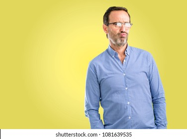 Handsome middle age man irritated and angry expressing negative emotion, annoyed with someone