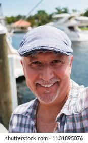 Handsome middle age man outdoor selfie portrait.