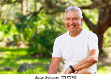 Handsome middle age man outdoor portrait in a park setting.