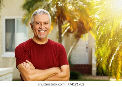 Handsome middle age man outdoor portrait in a home setting.