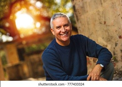 Handsome middle age man outdoor portrait.
