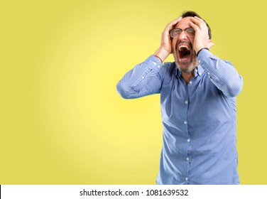 Handsome middle age man stressful keeping hands on head, terrified in panic, shouting